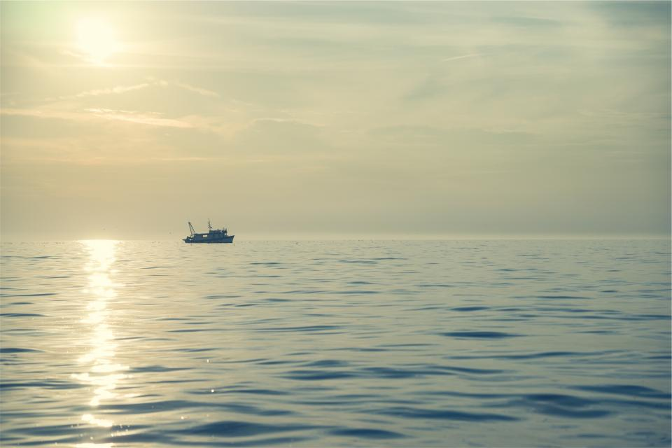 sunset boat ship ocean sea water horizon sky