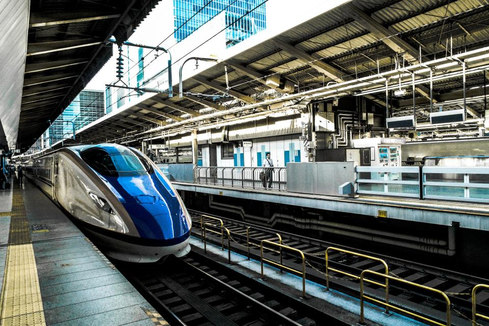 transportation bullet train platform station rail tracks ceiling industrial transit city urban metro