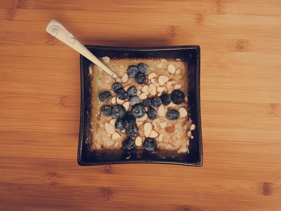 oatmeal blueberries almonds breakfast food spoon bowl