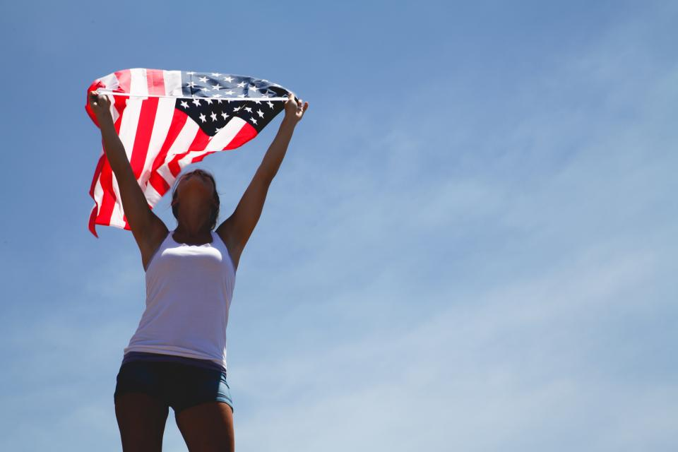 flag woman people raise clouds sky proud united states us stars
