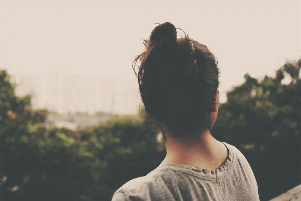 young girl woman brunette bun people
