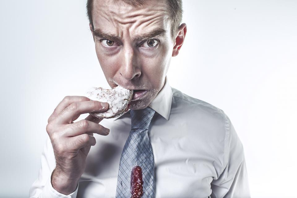 man guy dress shirt tie donut dessert food eating stain messy hand face people