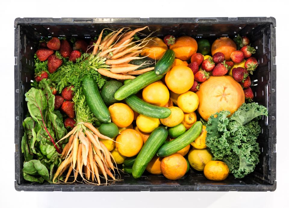 fruit vegetables box healthy food strawberries cucumbers oranges lettuce kale carrots