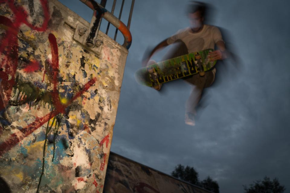 skateboarder skateboarding jump tricks graffiti spray paint