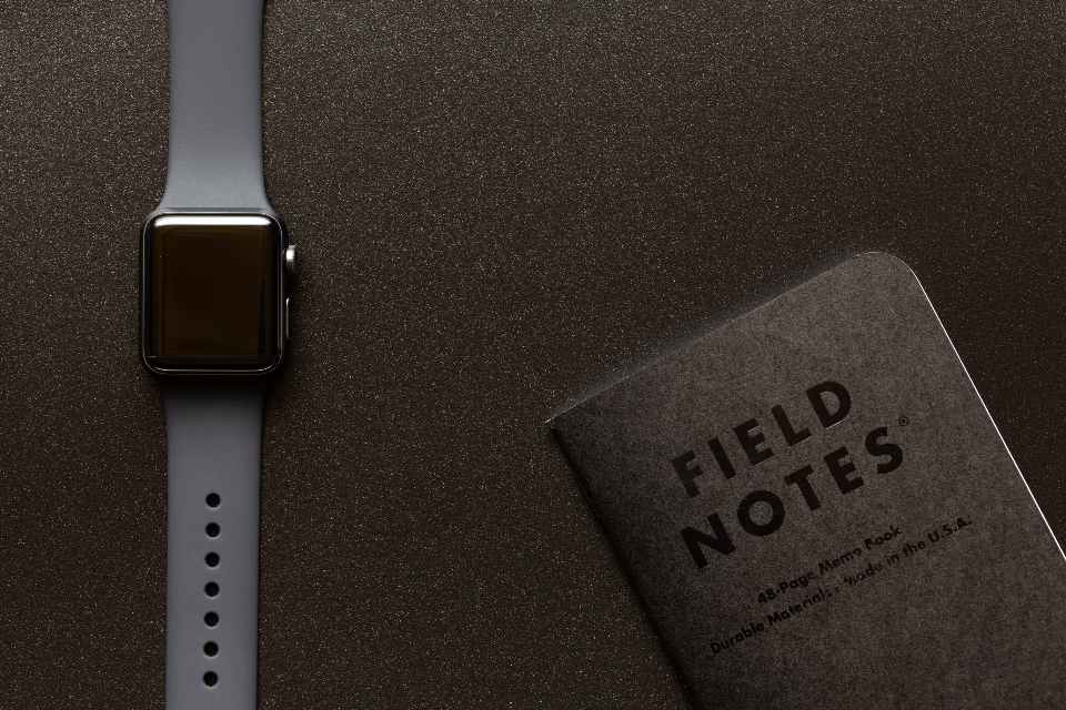 apple watch technology notebook field notes gear equipment flat lay top texture digital device gadget wearable information notes writing dark space gray