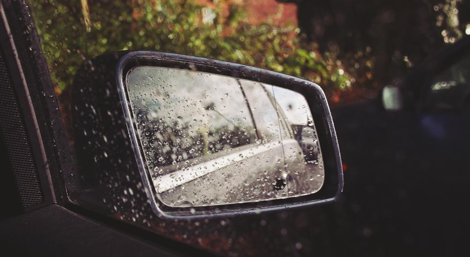 car mirror raining rain drops wet