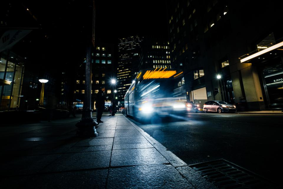 long exposure bus transportation photography dark night city urban lights establishment building hotel condominium