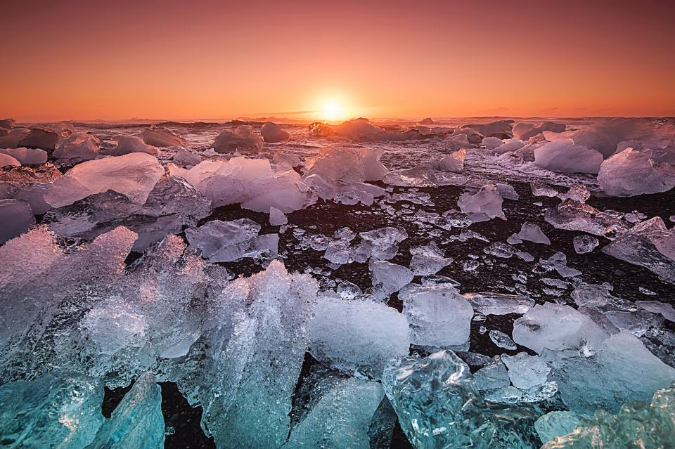 sea ocean coast shore nature ice iceberg sunset sunlight