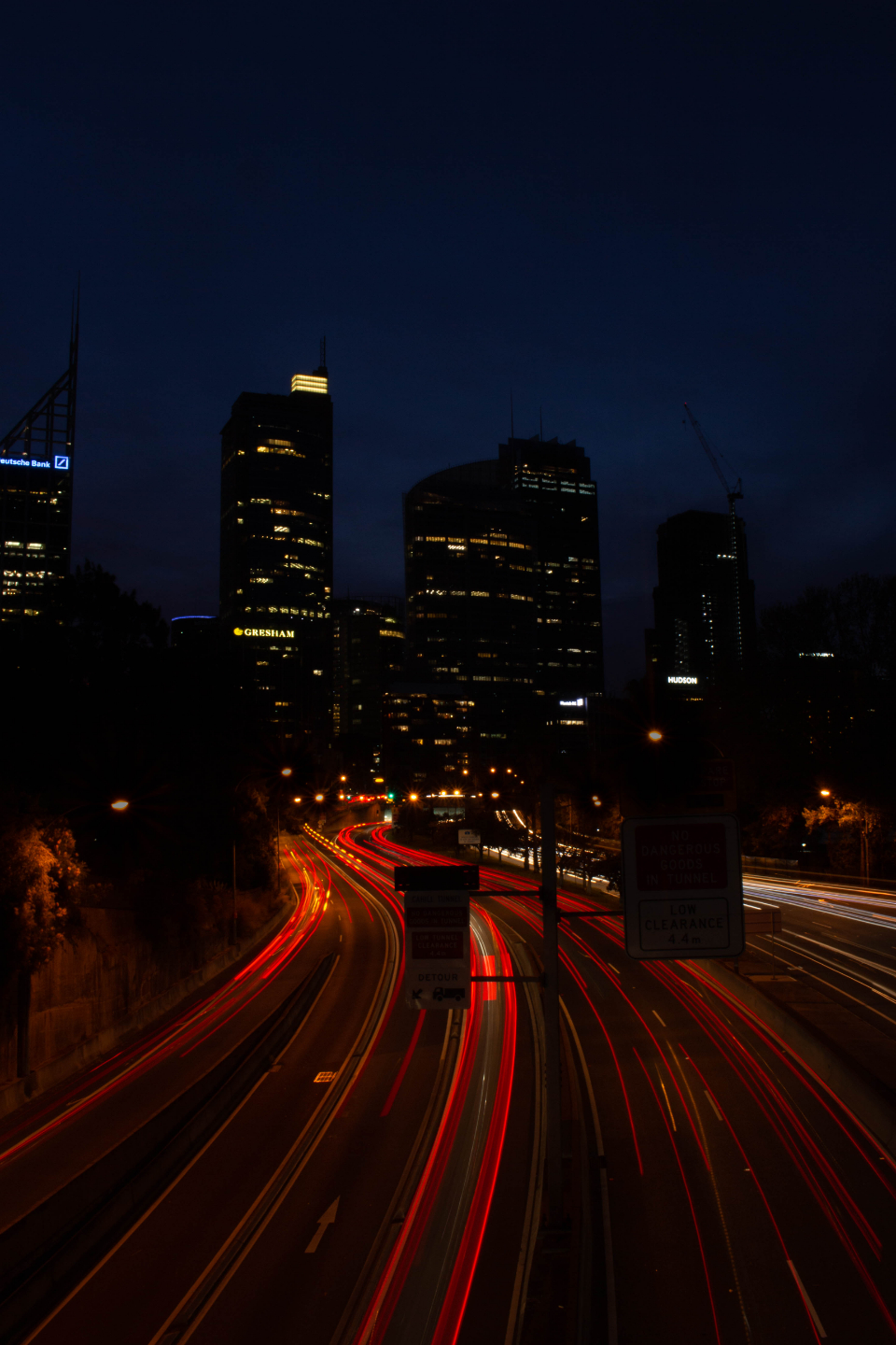 city light trails night dark urban cars headlights busy buildings commute travel transportation traffic