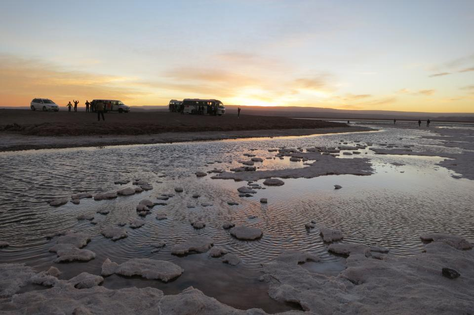 Laguna Cejar Chile water sand sunset busses sight seeing people