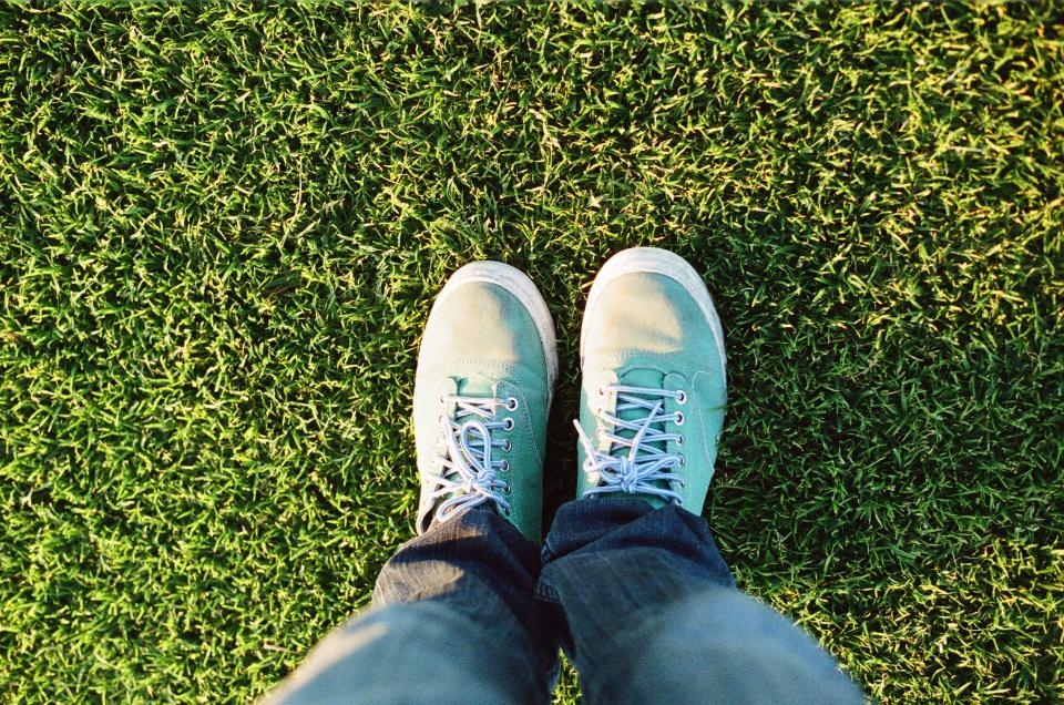 shoes sneakers laces turquoise jeans pants feet grass