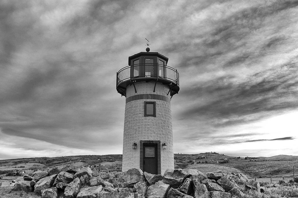 grey sky clouds lighthouse door rocks