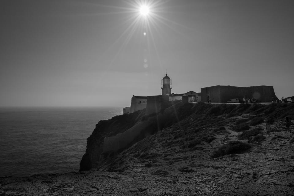 Cape Saint Vincent lighthouse coast ocean sea sunlight black and white