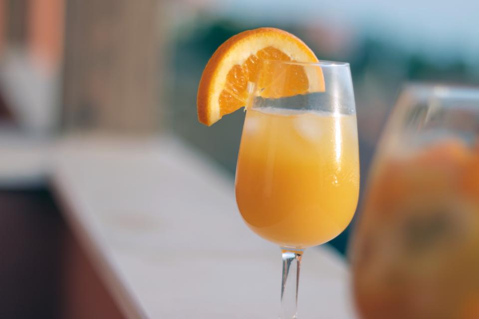 mimosa orange juice orange slice glass drink beverage breakfast
