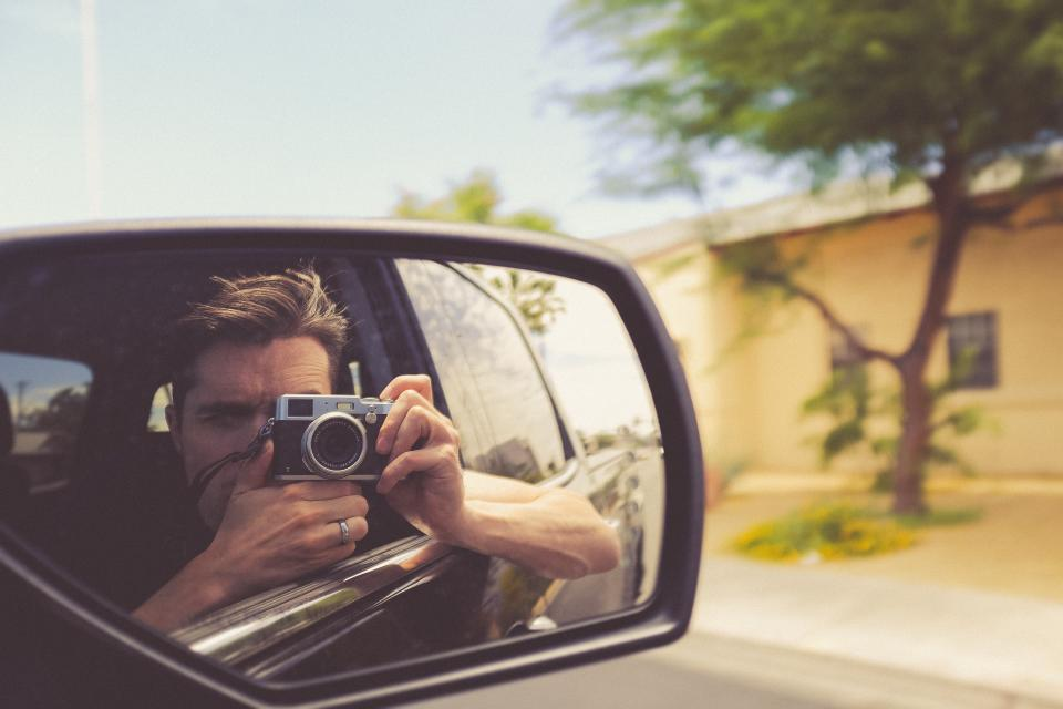 car side mirror vehicle road trip people man camera photographer travel