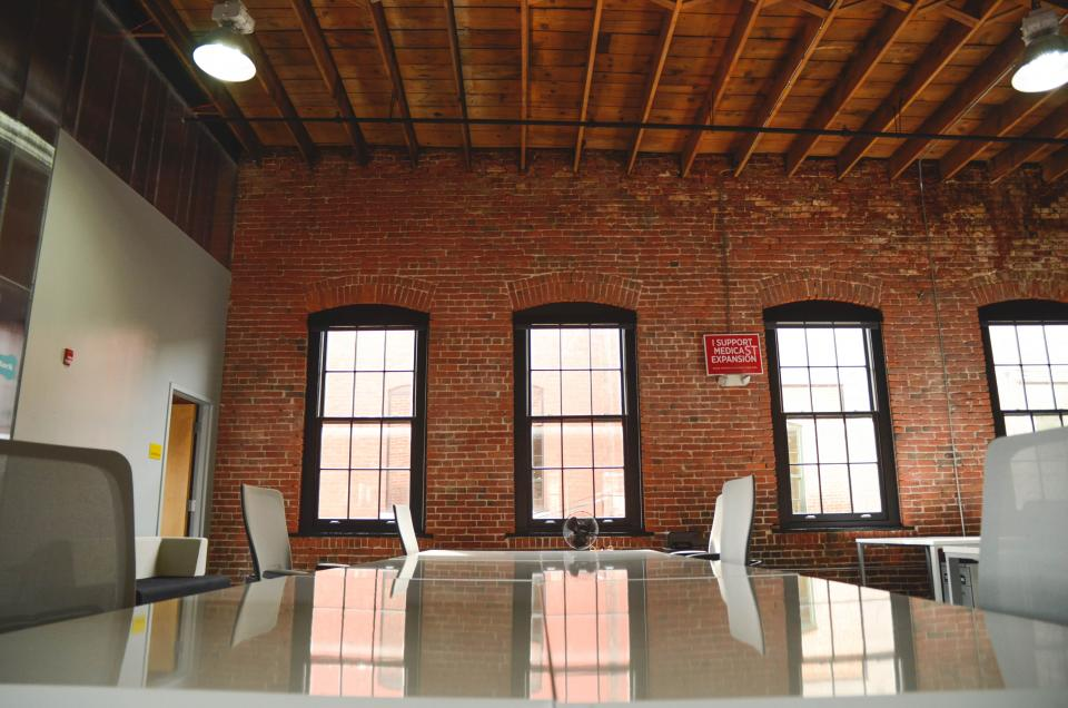 office startup business bricks windows chairs table meeting