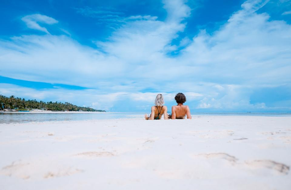 sea nature horizon blue sky clouds summer vacation outdoor white sand beach shore people man woman couple travel