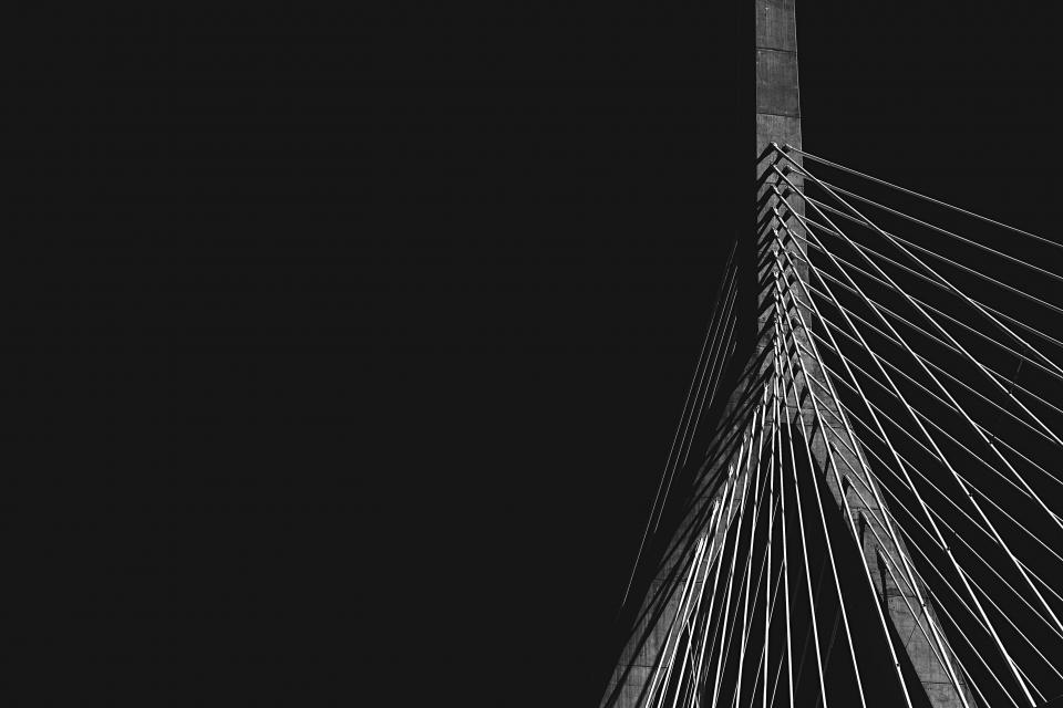dark black and white infrastructure cable-stayed bridge