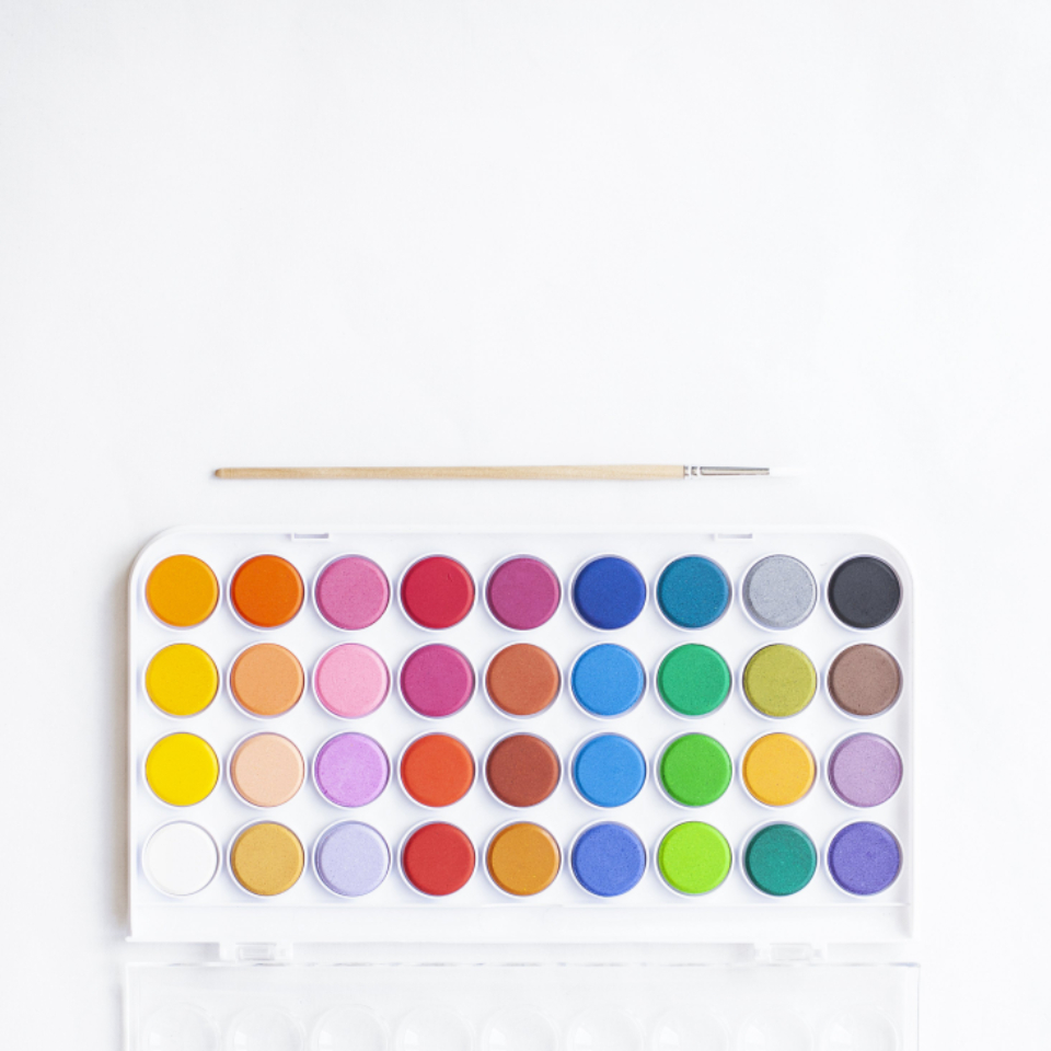 watercolor paint palette box colorful art artist painter rainbow brush water simple clean minimal brush top flat lay