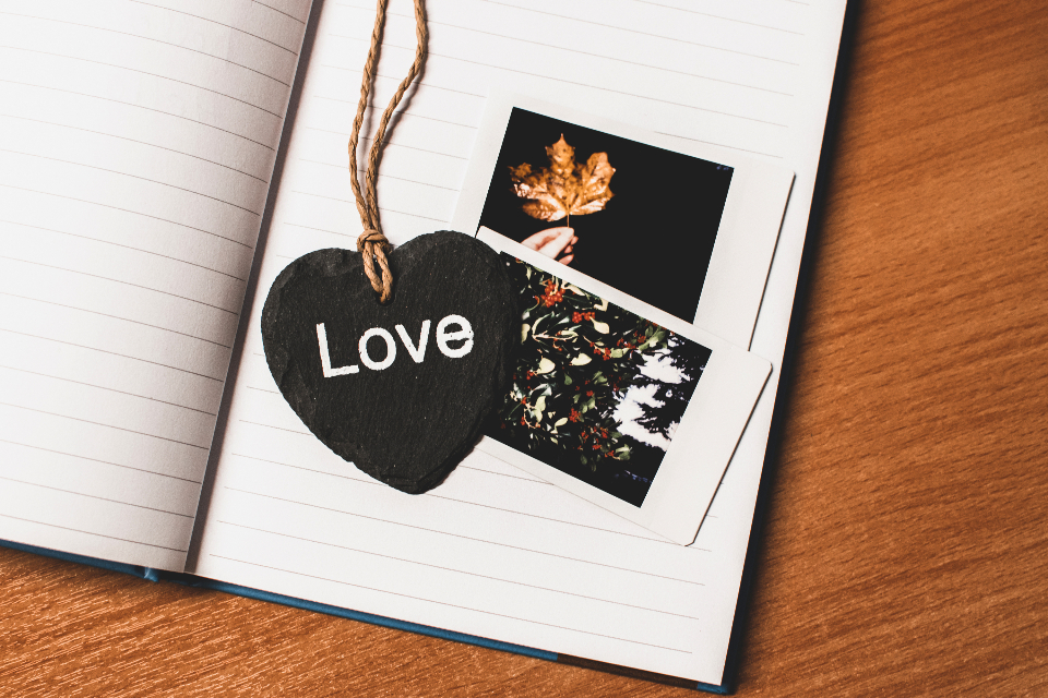 love heart message photo photography notepad white paper lines necklace string cord wood desk