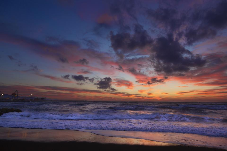 nature landscape water ocean sea waves splash beach shore sand sky clouds horizon fiery purple orange