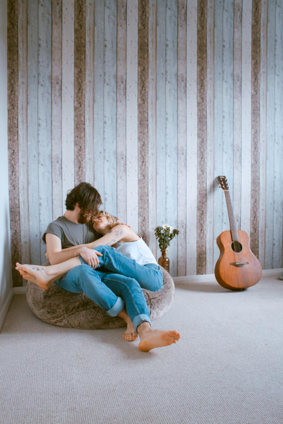 people man woman couple love hug room guitar wall