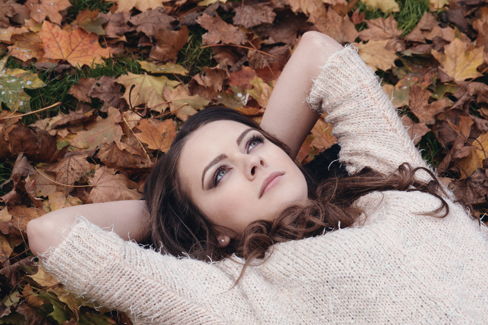 romantic park feeling in love autumn yellow portrait nature young season fall leaf female person outdoor lifestyle face woman people colorful seasonal fashion cute hair golde beauty girl lying down leaves people thinking