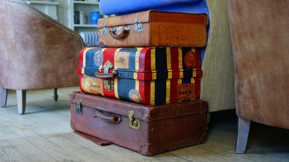 still items things suitcases luggage stack pile vintage colorful couches travel journey trip