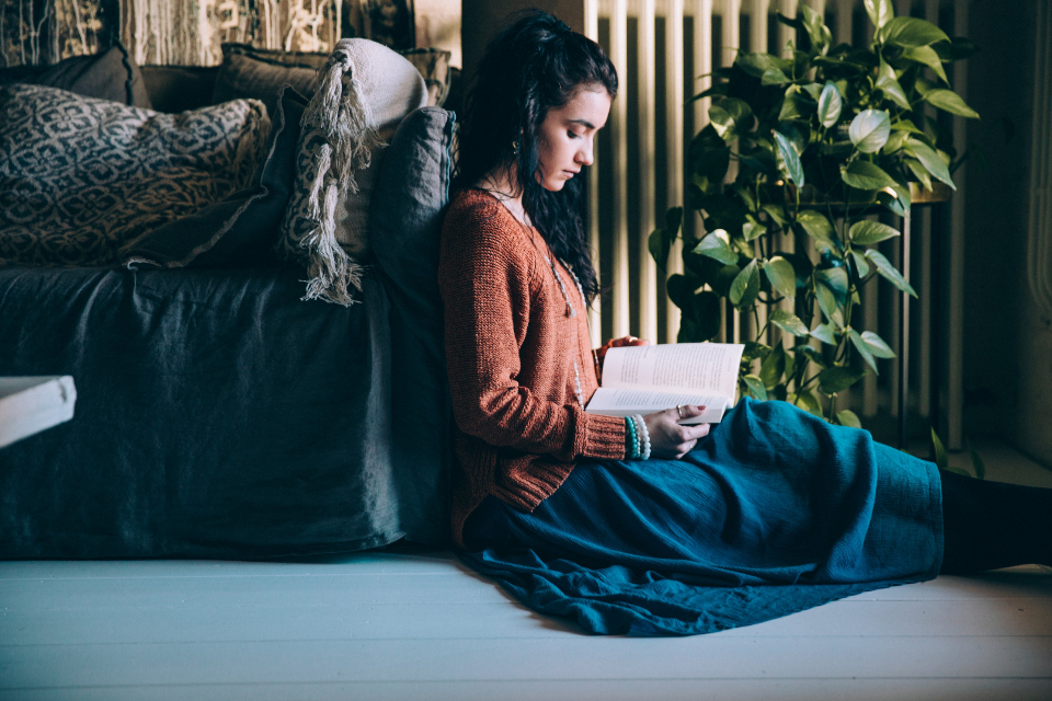 woman reading book female girl person literature leisure enjoyment relax indoors home studying casual