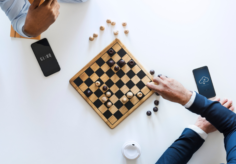 business people business strategy challenge chess closeup competition decision digital device diversity english european flat lay flatlay game german hands help