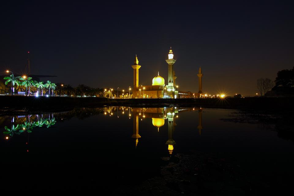 water ocean sea dark night reflection lights park trees pole building tower architecture