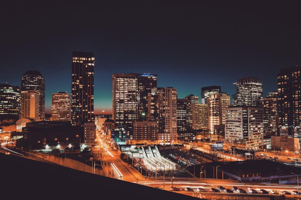 cityscape buildings architecture city urban downtown lights high rises towers dark night evening roads