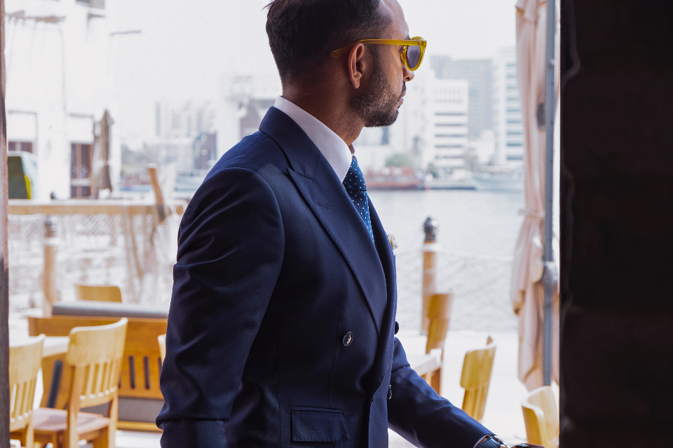 businessman blue suit power sunglasses walking distracted beard model fashion tie bar restaurant