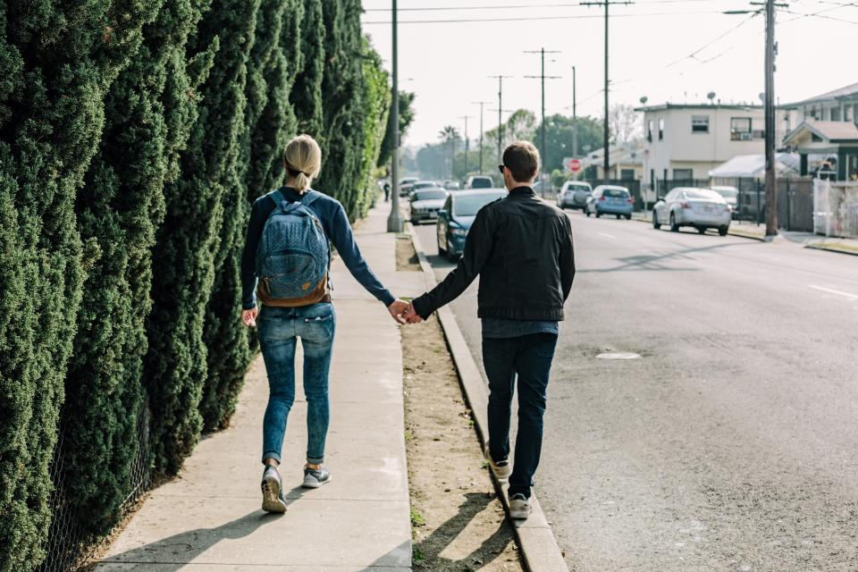 couple love romance holding hands girl woman guy man people walking pedestrians sidewalk street road pavement cars city urban neighborhood neighbourhood sunshine
