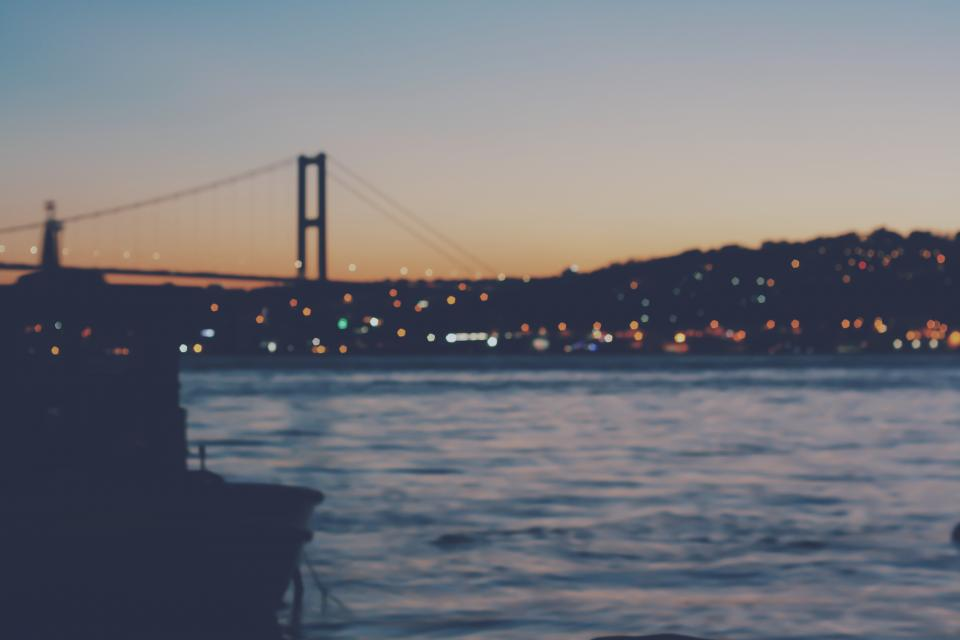 urban city establishment building structure infrastructure bridge bokeh dark night lights water ocean sea sky sunset