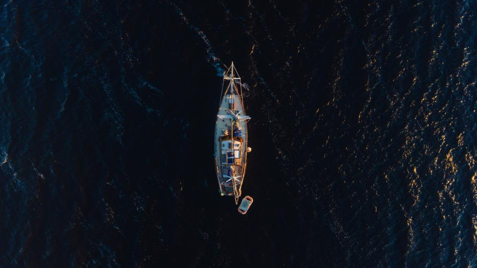 aerial view dark water transportation ocean sea sailing boat