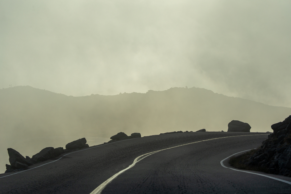 misty mountain road curvy fog clouds sky driving cliffs fall nature landscape travel route hills