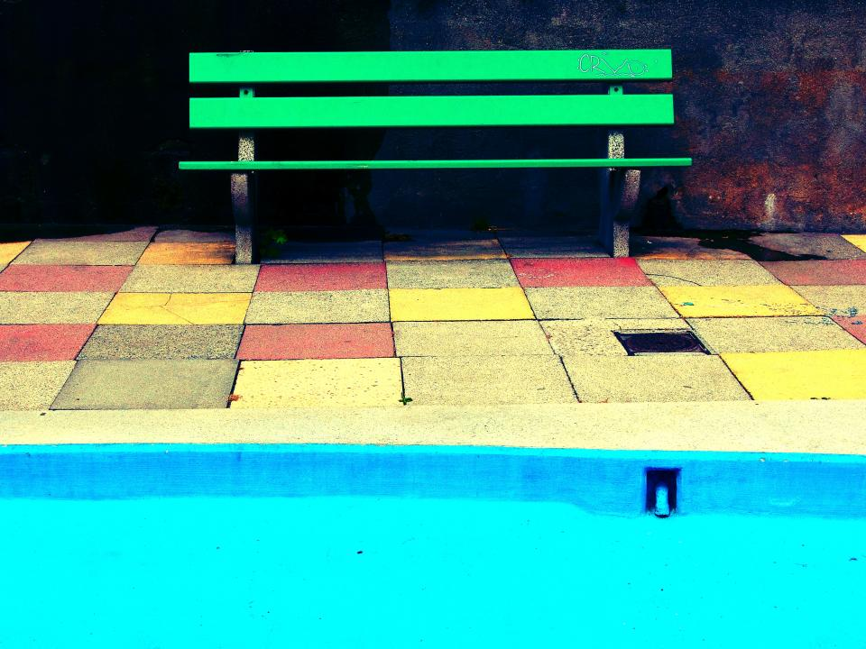 green bench blue pool tiles bright