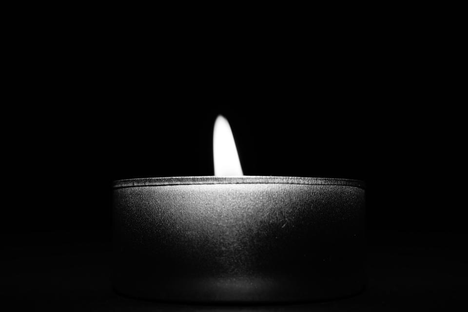 black and white candle light dark night