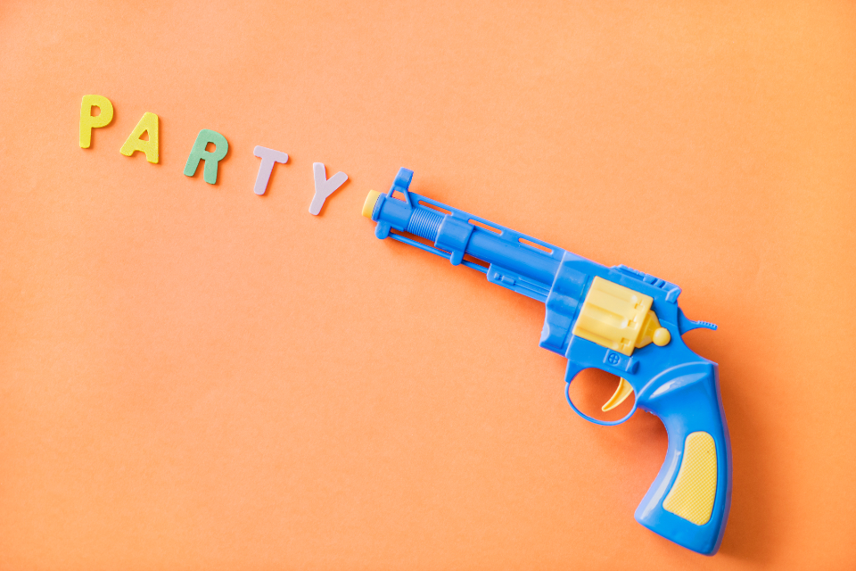 childhood colorful defense fake fight firearm fun game gun handgun isolated joy loaded object orange party pastel pistol plastic play playful protection retro revolver safety