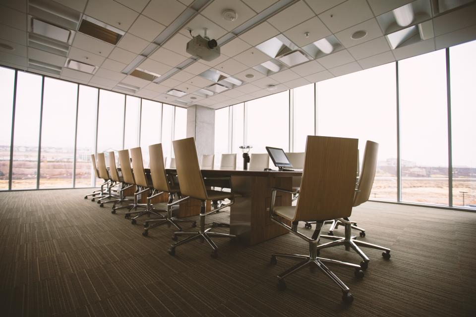 office work business conference area meeting room chairs perspective windows floor ceiling table desk laptop