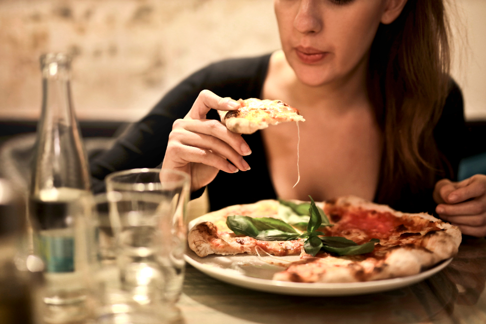 woman pizza food restuarant eat dinner drink girl italian knife meal plate tomato wine