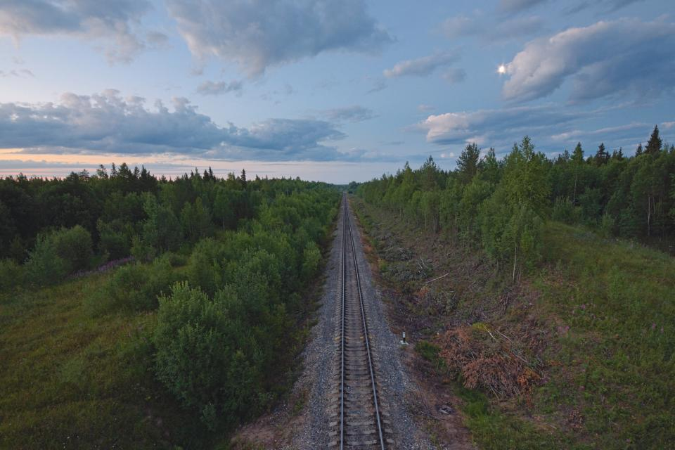 trees railway grass sky track nature outdoor clouds landscape forest green travel