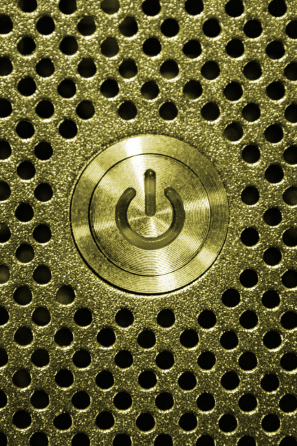 gold power button computer pc electronics shutdown metal texture pattern macro close up shiny object technology