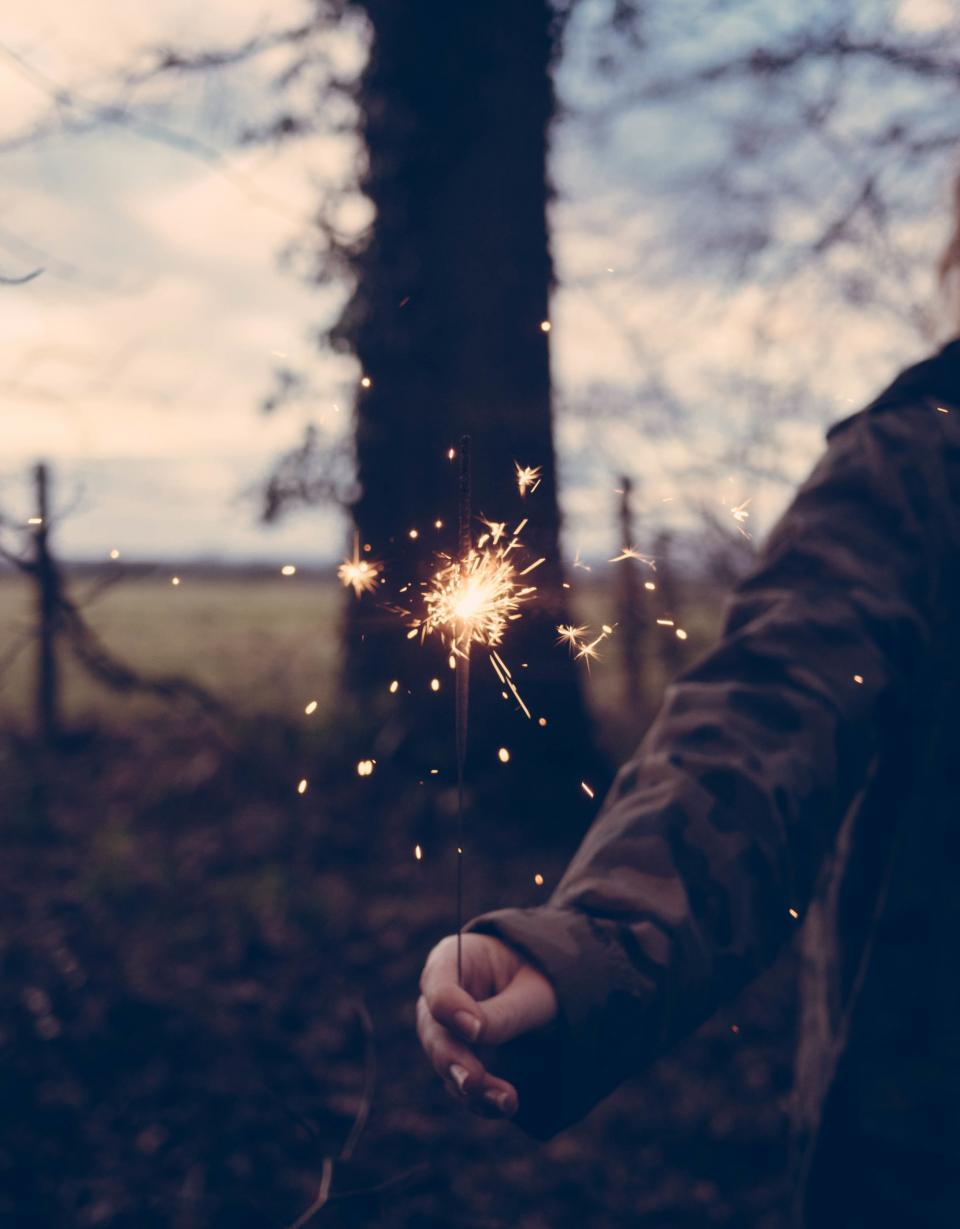 spark people fire light trees nature woman hand