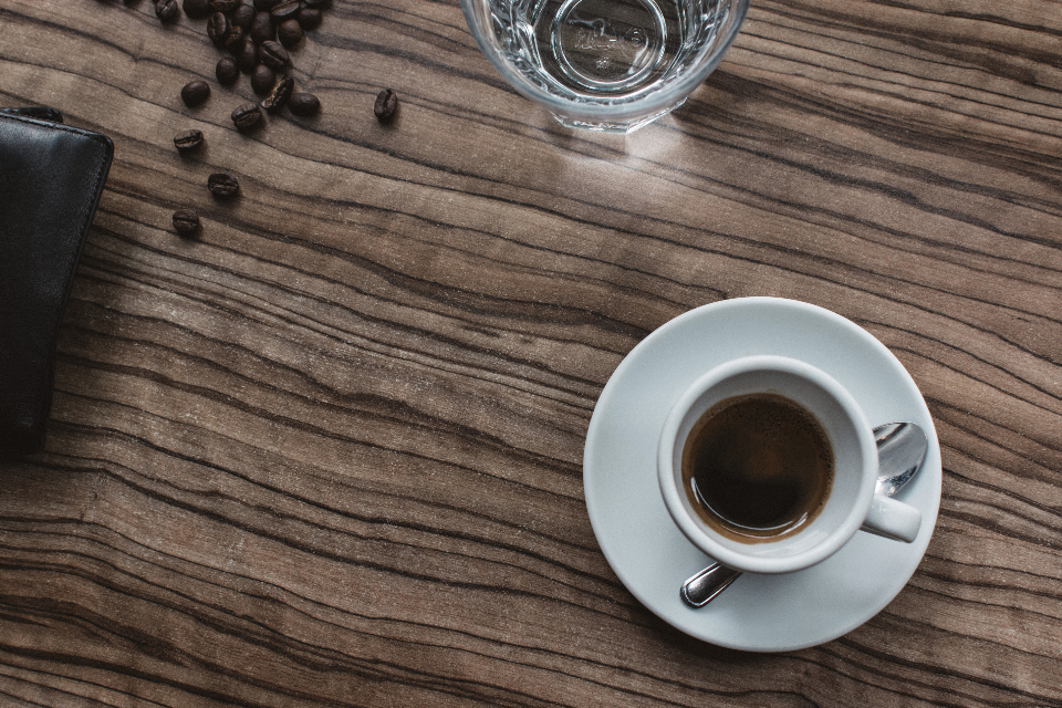 espresso coffee cup wood table glass coffee beans morning wallet cafe