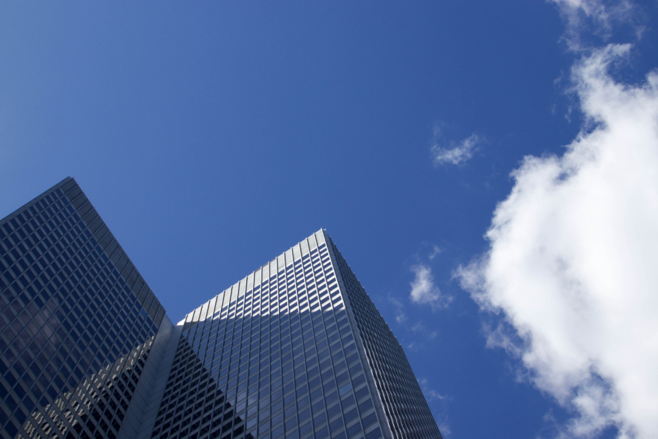city windows sky clouds downtown urban skyscraper architecture daytime business copyspace perspective exterior modern buildings facade minimal