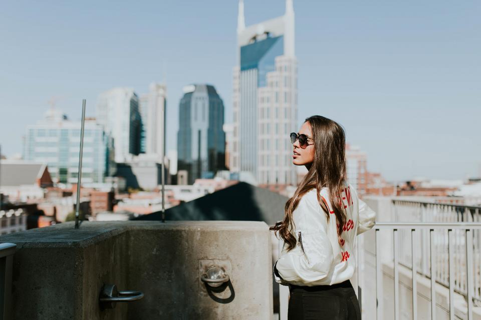 architecture building infrastructure sky blur people girl alone sunglasses sunny day beauty hairstyle