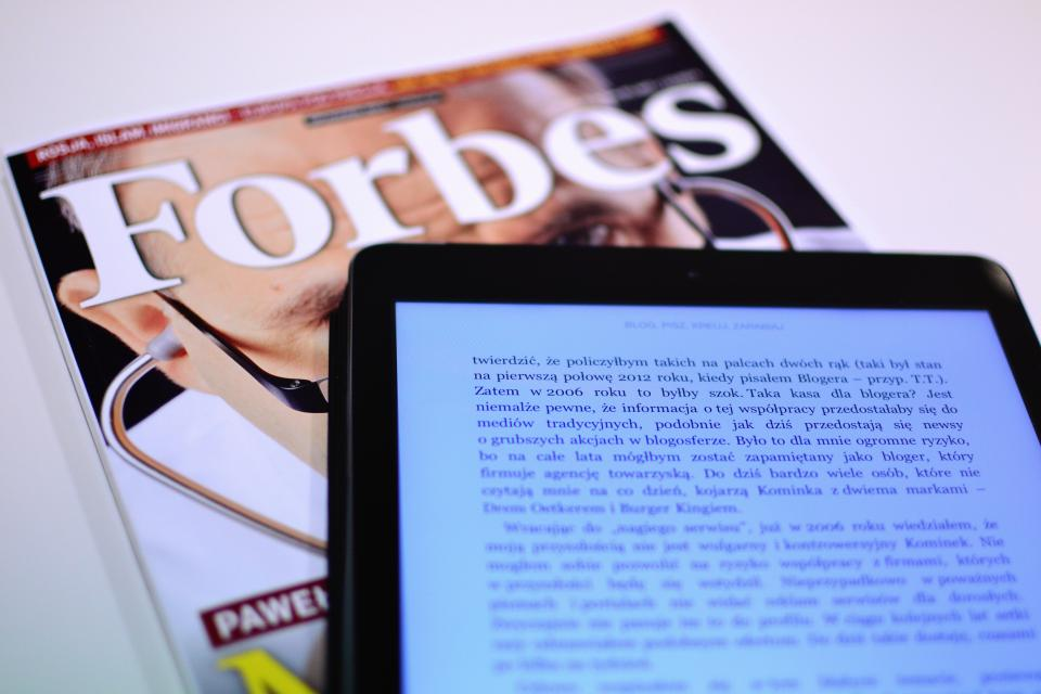 Forbes magazine reading