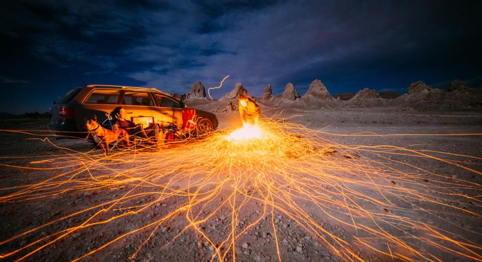 car vehicle dark night couple people man woman dog pet animal picnic hill rocks landscape nature clouds sky sparkling fire light long exposure